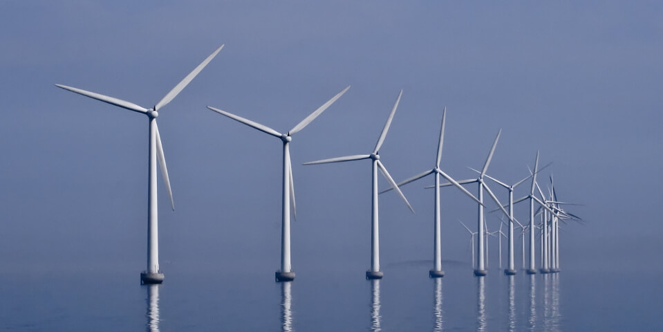 Improving wind turbine performance while reducing noise using our design framework.